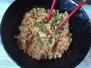 Veggie fried brown rice with green onion and scrambled egg.