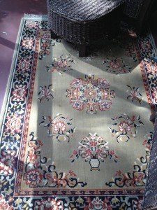 A vintage rug for the porch.