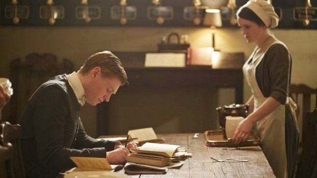 """Oh, Alfred.  You are so cute when you are studying Larousse Gastronomique.""  (Note to reader:  that French gastronomy tome won't actually be published until 1938.) Photo credit: ITV for MASTERPIECE"
